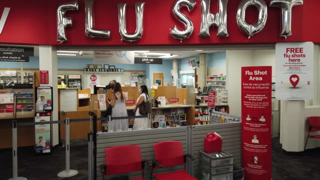 helium balloons spell out flu shot at a cvs health corp pharmacy offering a free flu shot vaccine to customers in miami fl us on wednesday september... - helium stock videos & royalty-free footage