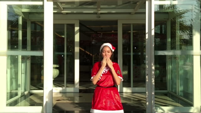 hello and goodbye kiss by young woman in Christmas time , slow motion