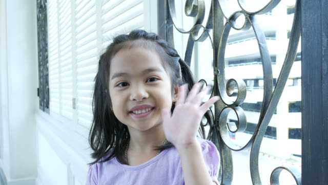 hello, goodbye by asian little girl - child waving stock videos & royalty-free footage