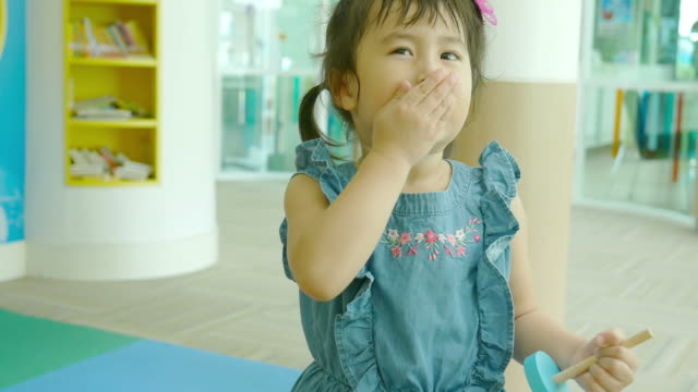 hello, goodbye kiss by Asian little girl