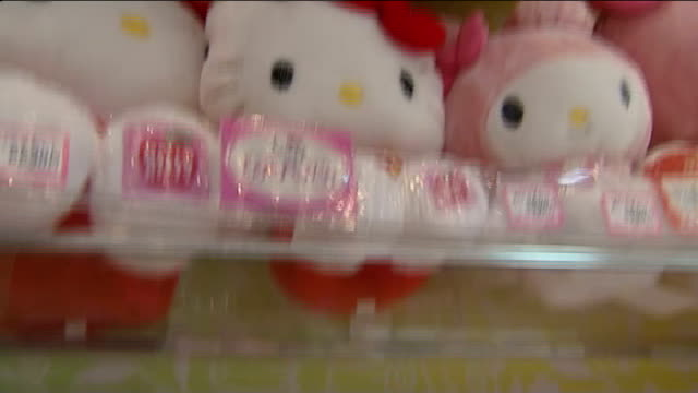 'hello kitty' products on display in shop close shots of hello kitty merchandise on display including bags shoes cuddly toys / hello kitty drinks... - hello kitty stock videos and b-roll footage
