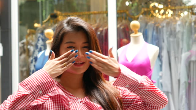hello sign and blowing a kiss by young Asian woman