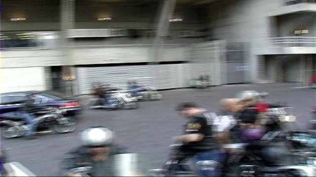 hell's angels' motorcycle club ride through south london past imax and london eye group of hell's angels bikers standing next motorbikes on south... - biker gang stock videos & royalty-free footage
