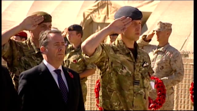 helmand province: camp bastions british buglers playing last post sot prince william saluting as last post played standing next to liam fox mp... - royal blue stock videos & royalty-free footage