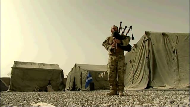 helmand province: ext sergeant scott methven playing bagpipes sot - sergeant stock videos & royalty-free footage
