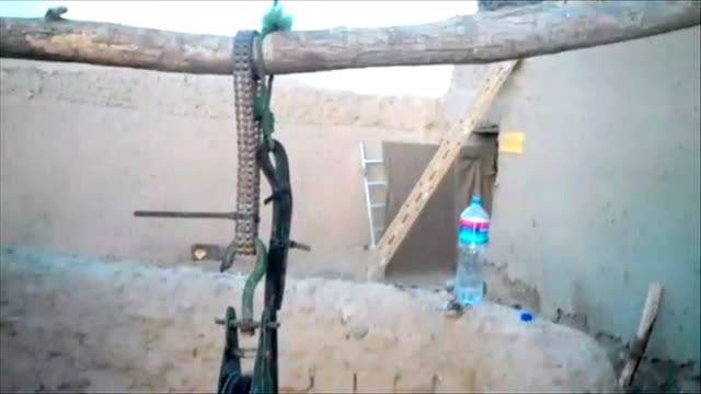 helmand province ext sergeant scott methven speaking to camera sot now here at one of the checkpoints / not much here close up of handwritten sign... - general electric building stock videos and b-roll footage