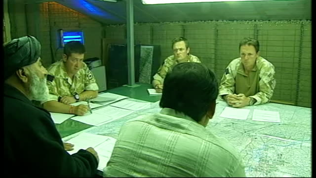 Helmand Province Reporter shaking hands with Afghan district governor at meeting in British military base SEQUENCE District governor speaking through...