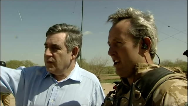 helmand province lash kagar showal ext army chinook helicopter landing in field as british troops stand guard gordon brown mp greeting troops as... - digital camera stock videos and b-roll footage