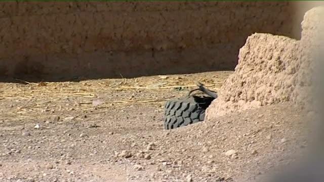vidéos et rushes de helmand province lashkar gar ext pov shot from on top of mastiff armoured vehicle as along on patrol shot of british mastiff armoured vehicle towards... - taliban