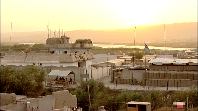 helmand province sangin ext sun rising on british army base - military base stock videos & royalty-free footage