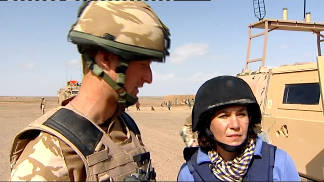 soldiers on armed humvees patrolling desert road flying officer robin fowler speaking to reporter about what the reconnaissance pod has picked up sot... - 2010 video stock e b–roll