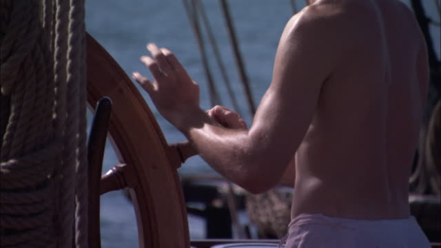 helmsman on replica of hms endeavour. - mittlerer teil stock-videos und b-roll-filmmaterial
