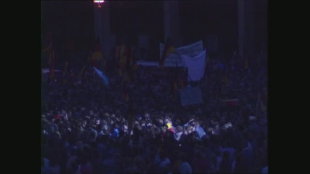 helmut kohl visits dresden; east germany: dresden: ext / night ts kohl through crowds; ls kohl addressing crowd; crowd cheer: - dresden germany stock videos & royalty-free footage