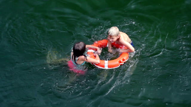 Help concept. Lifebuoy for drowning kids in open sea or ocean water