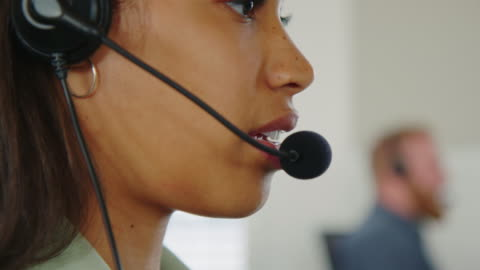 help desk employee in close-up - headset stock videos & royalty-free footage
