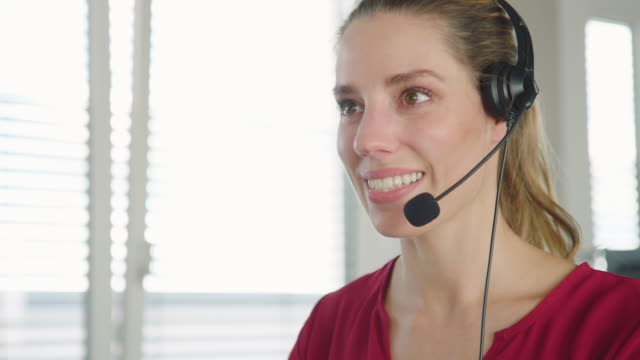 help desk operator talking on a headset - customer service representative stock videos & royalty-free footage