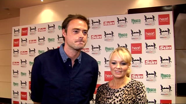vídeos de stock, filmes e b-roll de help for heroes charity concert: celebrity interviews; england: london: twickenham rugby ground: int ** beware contains flash photography *** jamie... - jamie theakston