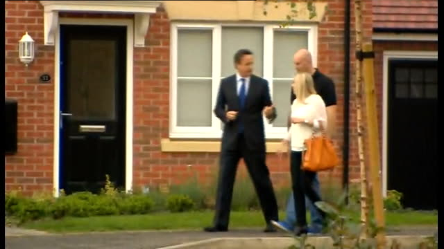 david cameron visits housing estate and natwest bank in northampton england northampton weston favell ext david cameron mp interview sot on help to... - housing development stock videos & royalty-free footage