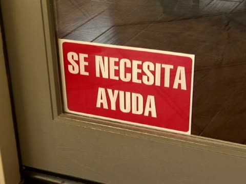 cu, zi help wanted sign in window (in spanish), california, usa - help wanted sign stock videos and b-roll footage