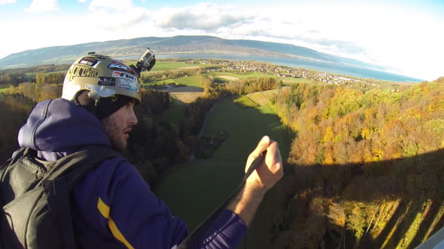 pov helping base jumper prepare to jump off a highway bridge - base jumper stock videos & royalty-free footage