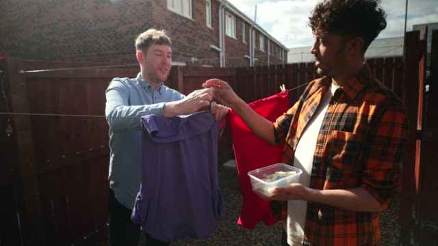 a helping hand - washing line stock videos & royalty-free footage