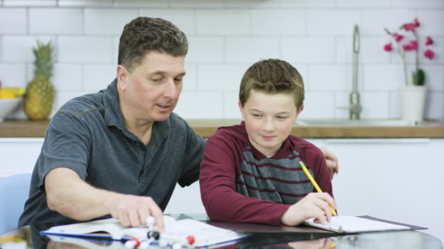 helping hand with homework - fathers day stock videos & royalty-free footage