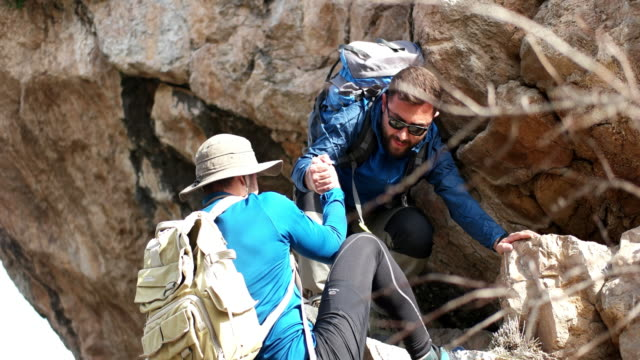 helping hikers - clambering stock videos & royalty-free footage