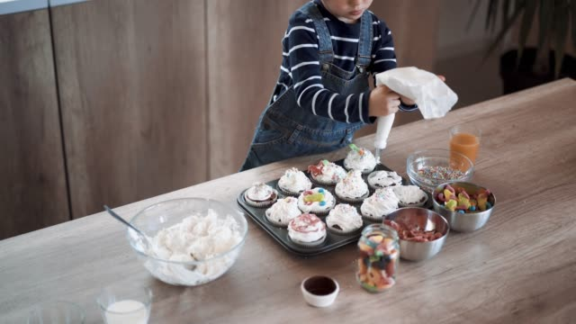 helping his mom to make birthday muffins - cupcake stock videos & royalty-free footage