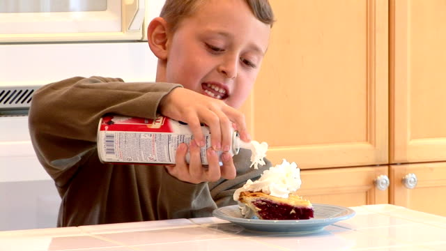 helping son to eat healthy - whipped cream stock videos and b-roll footage