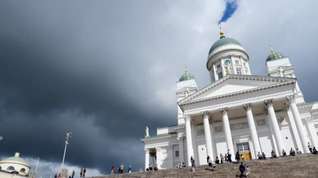 helsinki cathedral and dark clouds in finland - helsinki video stock e b–roll