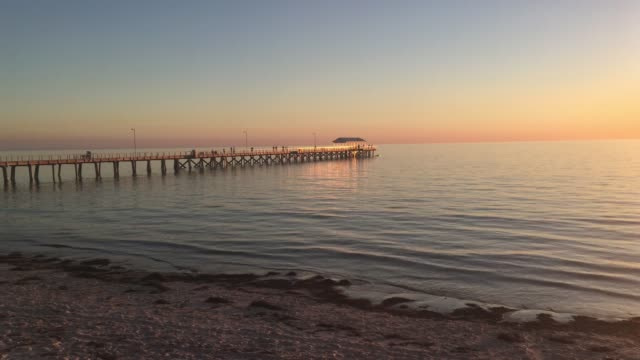 henley beach pier at sunset - jetty stock videos & royalty-free footage