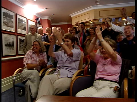 henley leander club supporters waiting for result of photo finish gv supporters celebrating as result shows team gb won vox pops supporters sot ms bv... - canottaggio senza timoniere video stock e b–roll