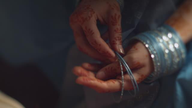 henna tattoo on hands - bracelet stock videos & royalty-free footage