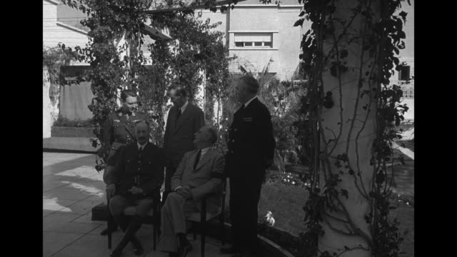 stockvideo's en b-roll-footage met vs henri giraud french high commissioner for north africa sits outdoors with us president franklin roosevelt during a photo op at the casablanca... - generaal militaire rang