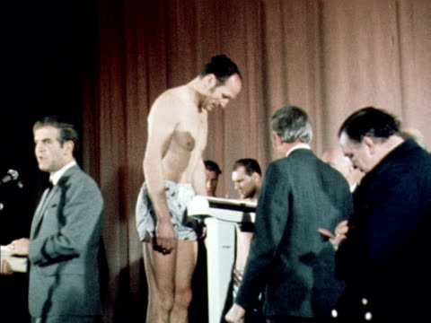 henry cooper and jack bodell are weighed at a press conference prior to their british heavyweight title fight march 1970 - heavyweight stock videos and b-roll footage