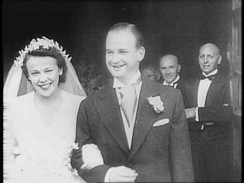 Henry Ford and Clara Ford enter the church / Edsel and Eleanor Ford enter the church / crowds gather nearby / Benson Ford and new wife pose at church...