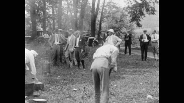 henry ford and others washing, chopping wood, cooking on a camping trip, usa - three people stock videos & royalty-free footage