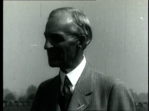 vidéos et rushes de henry ford holds a conversation while clad in a jacket and tie / united states - 1952