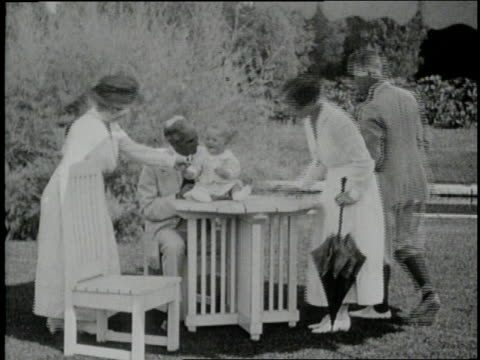 henry ford holds and plays with his grandson henry ford ii - henry ford stock videos and b-roll footage