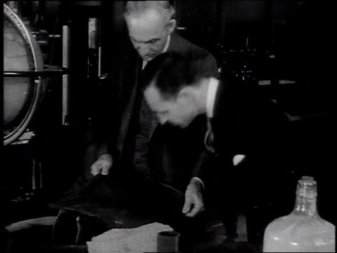 henry ford inspects blueprints with his son edsel ford / united states - ヘンリー・フォード点の映像素材/bロール