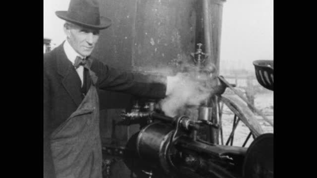 henry ford manually igniting large farm machine engine, plowing field, meeting with men in office, michigan, usa - ヘンリー・フォード点の映像素材/bロール