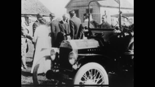 henry ford, men and women shaking hands with each other while standing in garden by car, usa - medium group of people stock videos & royalty-free footage