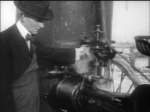 b/w henry ford operating steam engine / documentary - locomotive stock videos & royalty-free footage