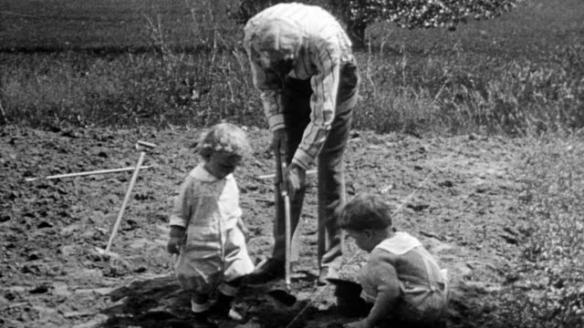 henry ford planting a garden with his grandchildren henry ford ii and benson - henry ford stock videos and b-roll footage