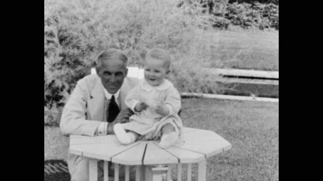henry ford playing with toddler in garden, michigan, usa - toothy smile stock videos & royalty-free footage