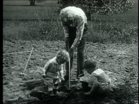 henry ford plays with his grandchildren and tinkers with a steam engine / united states - henry ford founder of ford motor company stock videos & royalty-free footage