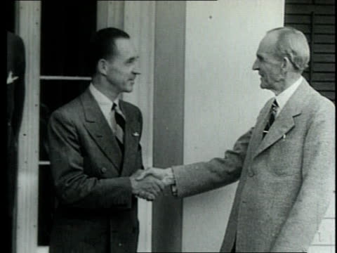 stockvideo's en b-roll-footage met henry ford shaking hands with son, edsel, and campaigning on behalf of alf landon / united states - 1936
