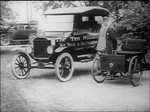 b/w henry ford showing other man car / documentary - フォード・t型モデル点の映像素材/bロール