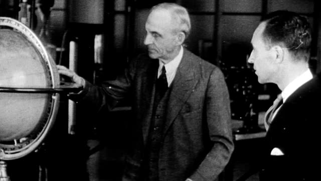 henry ford standing next to globe and reviewing materials with worker - ford stock-videos und b-roll-filmmaterial