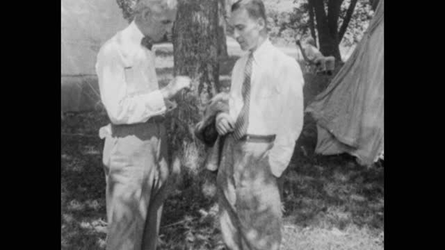 henry ford washing clothes by a river; ford, thomas edison and others eating in tent with a large lazy susan on the table during camping trip, usa - chair stock videos & royalty-free footage